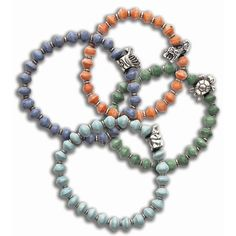 """Paper Beaded Charm Bracelets.  Beads made with beads of recycled paper, hand rolled by women in Africa, and assembled there by artisans--all earning fair wages in a safe environment. Plus, 10% benefits wildlife conservation.With silver charm, and silver metal spacer. A non-toxic lacquer makes the beads water-resistant and durable.7"""" diameter.  #Gifts #Lifestyle #Girlfriends #GirlPower #Inspirations #Sisterhood #Friendship  #EarthDay #Recycle #Jewelry"""