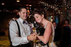 Ring bearer dog dancing with bride and groom at wedding at Lake Placid Lodge | wedding dog