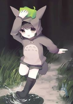 Anime girl dressed as totoro, so cute and i loke k ike how there's a little one on the grass.