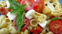 Rotini pasta is tossed with pesto, fresh mozzarella, and tomatoes for a colorful pasta version of Caprese salad.
