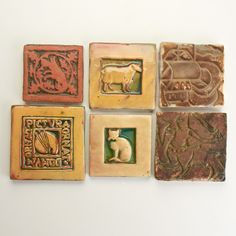 """MORAVIAN TILE WORKS  Thirty assorted tiles in various designs, Doylestown, PA, 20th c.  Some marked  Most: 4"""" sq."""