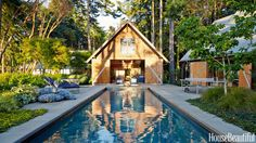 The addition of a garage and studio, both by Lawrence Architecture, created a pool courtyard in a Pacific Northwest house decorated by Markham Roberts. Barn doors open onto the patio from the poolhouse on axis with the pool.   - HouseBeautiful.com