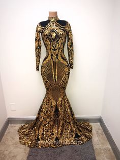 Sparkly bright gold sequin and black lining prom dress with a turtle neck and zipper back. This trumpet floor length long sleeve prom gown is lined with a black thin fabric to minimize the contact of the sequin irritating the skin. Black Girl Prom Dresses, Gold Prom Dresses, Prom Outfits, Homecoming Dresses, Evening Dresses, Summer Dresses, Wedding Dresses, African Prom Dresses, Prom Gowns