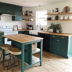 Benjamin Moore Forest Green. Green painted kitchen cabinets.
