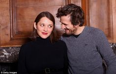 The look of love? Pregnant Marion Cotillard seemed to look at her beau Guillaume Canet with disdain on Wednesday, as they promoted their film Rock'n Roll