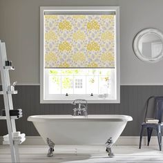 The Hydrangea Primrose roller blind is a gorgeous statement accessory for your home. The yellow and grey tones will blend in perfectly with the neutral colours in your home.