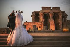 """A newlywed couple spell the word """"love"""" with their hands during their wedding photo shoot at the ancient temple of Kom Ombo, north of Aswan, southern Egypt, Thursday, April 30, 2015. (AP Photo/Mosa'ab Elshamy)"""
