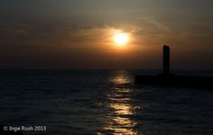 South Haven Lighthouse - Southern Pier by Inge Rush, via Flickr
