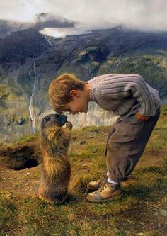 Nose to nose:  A marmot greets 8 year-old Matteo on the slopes of the Austrian Alps. By Rachel McDermott, DailyMail.co.uk