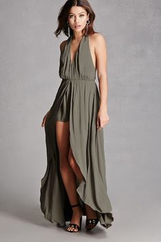 A woven maxi romper featuring a high-low skirt overlay, a buttoned halter neck, and a partially elasticized back. This is an independent brand and not a Forever 21 branded item.