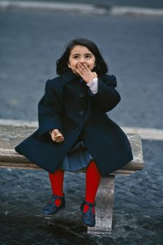 Today's photo is of a little girl laughing at St. Paul's Basilica, Rome, Italy.