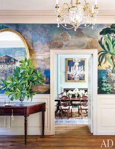 A doorway is framed by Dufour et Leroy's famous Les Paysages de Télémaque dans l'île de Calypso wallpaper