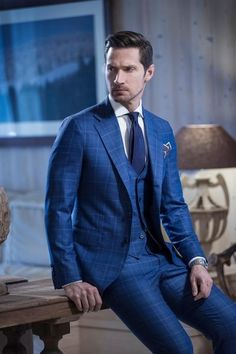 3-piece window pane suit in indigo blue paired with elegant necktie and pocket square.