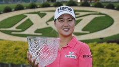 Minjee Lee, of Australia, holds the winners trophy after winning the rain delayed Kingsmill Championship LPGA golf tournament at the Kingsmill Golf Club in Williamsburg, Va., Monday, May 18, 2015. (AP Photo/Steve Helber)