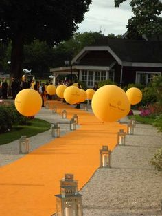 Balloons with Brand or Company Name leading up to the entrance of the corporate event with carpet in company colors