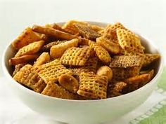 Hot and Spicey Chex Mix:  1 stick butter, 2 tbsps Annie's worcestershire sauce, 3 tbsps red hot sauce, 2 1/2 tsp Penzeys spicey seasoning salt, 3 cups - corn, rice and wheat Chex cereal, 2 cups pretzel stix, 1 cup roasted peanuts.  Bake 250 degrees, 1 hour, stir every 15 minutes.