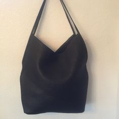 """As seen in Niche Magazine. Made from High Quality Leather. It's roomy and chic. It's suitable for travel, day to day, or work.     Details:     Purse measures approximately 15"""" Wide X 15"""" Long  Double Strap  - 10"""" Drop  Interior Pocket for I-Phone or Keys Measures 6"""" X 6""""   Snap Magnetic Closure"""