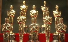 As recognizable as any Hollywood celebrity, the golden Oscar statuette has been around since the first Academy Awards ceremony in The iconic trophy depicts a knight holding a sword and standing on a film reel with five spokes, each representing . The First Academy, First Academy Awards, Film Academy, John Cho, Kevin Hart, Oscar Party, Oscar Trivia, Oscars Gift Bag, Robert De Niro