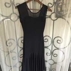 "Sexy black dress..50"" long..medium size Poly/spandex/nylon blend...sexy black dress..medium size...overall length is 50""...pullover so no rear zipper!! Dresses"