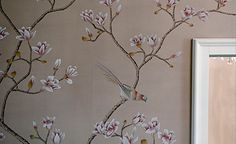 A delicate color scheme rests on the walls with complementary white peonies, magnolia, and plum blossoms, by Misha handmadewallpaper