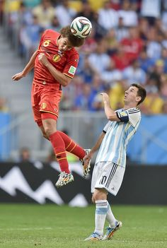 Axel Witsel of Belgium against Lionel Messi of Argentina in the 2014 World Cup