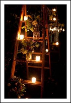 ladders with candles and flowers for ambiance-would be cool for a backyard party.
