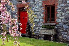 Traditional Irish red doorway - by roblisameehan @ flickr cc