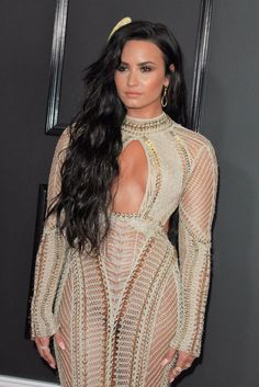In preparation for the Oscars, I thought we could check out the 59th Grammy Awards in Los Angeles, some two weeks ago. And oh boy! Am I glad I did! We would almost have missed out on Demi Lovato in a lovely dress and with possibly no underwear. I'll take the possibility and raise you …