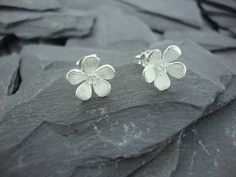 silver hibiscus stud earrings by summer and silver | notonthehighstreet.com
