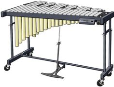 VIBRAPHONE The vibraphone (also known as the vibraharp or simply the vibes) is a musical instrument in the struck idiophone subfamily of the percussion family. The vibraphone is similar in appearance to the xylophone, marimba and glockenspiel. Each bar is paired with a resonator tube having a motor-driven butterfly valve at its upper end, mounted on a common shaft, which produces a tremolo or vibrato effect while spinning. The vibraphone also has a sustain pedal similar to that used on a…