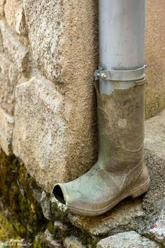 LOL - reuse an old gardening boot as a downspout drain