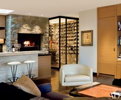 pizza oven and wine cellar in kitchen - Jennifer Aniston at Home Photos | Architectural Digest