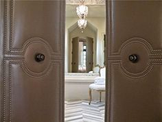Image result for Upholstering doors with leather and nail trim