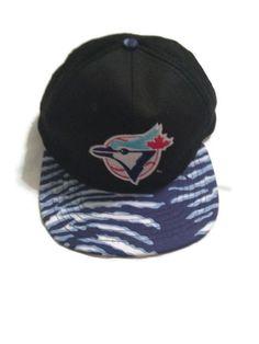 90 s Toronto Blue Jays Snapback Hat   Genuine MLB Merchandise   1990 s Baseball  Cap   Zebra Print   Animal Print   Adults One Size Fits Most 8795630361c4