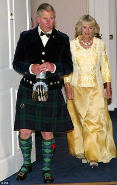 Prince Charles and Camilla- Not exactly the best picture of either of them, but pinned for Charles' less commonly seen Navy Doublet and sporran with bullion braids.