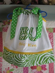 I would love this for my girls with HPU on the front and blue zebra on the bottom with yellow polka dot ribbon for ribbon ties.  Hmmmmm.....