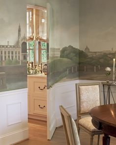 Dining room with landscape mural on hidden door | SOLIS BETANCOURT & SHERRILL