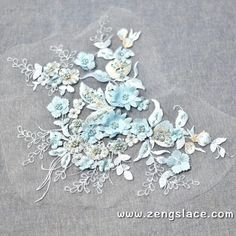 Check out this applique that comes with pink and blue, very delighful colors! Please visit www.zengslace.com or www.zeng.etsy.com, and search for ALA-45!