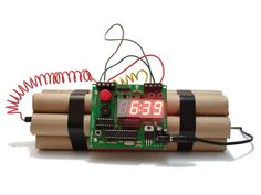 Defusable alarm clock. Won't quit making noise until you defuse it! The red wire or the blue...?