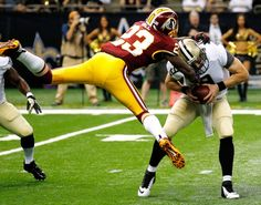 Drew Brees (QB) is sacked by Washington Redskins (CB) DeAngelo Hall in New Orleans, Sunday, Sept. 9, 2012. The Redskins won 40-32.