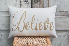 A personal favorite from my Etsy shop https://www.etsy.com/listing/482449911/believe-pillow-decor-pillow-gold-pillow