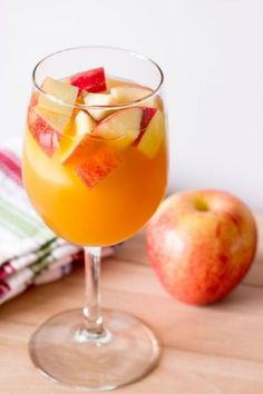 Sangria Recipes-Fruity Recipes for Sangria-CARAMEL APPLE SANGRIA.It's hard to beat the zesty combination of caramel vodka and Pinot Grigio on a warm summer day.Visit redbookmag.com for more sangria recipes.