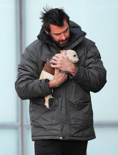 Gorgeous hunk Hugh Jackman with his French bulldog puppy. Lucky little guy!