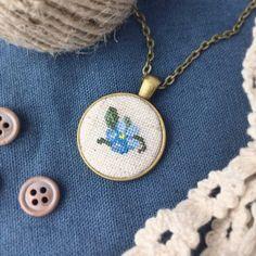 Forget-me-not cross stitch pendant by KoalahandmadeLeather on Etsy