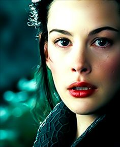 Arwen. She actually is of another world...and she can handle a sword.