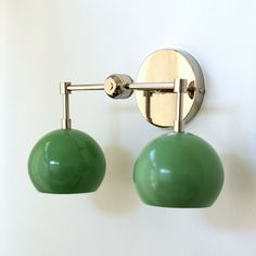 mid century modern style two light wall sconce in pastel green and chrome. Perfect for bathrooms, small spaces, kids' bathrooms, and more! Baby Boy Nursery Decor, Nursery Design, Small Space Design, Small Spaces, Wall Sconce Lighting, Wall Sconces, Sconces Living Room, Modern Lighting Design, Green Home Decor