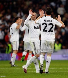 Xabi Alonso (R) of Real Madrid celebrates with Fernando Gago (C) after scoring during the La Liga match between Real Madrid and Atletico de Madrid at Estadio Santiago Bernabeu on March 28, 2010 in Madrid, Spain.