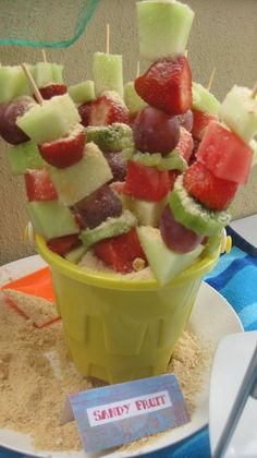 "Fruit skewers in sand (Im thinking the ""sand"" is crumbled graham crackers)"