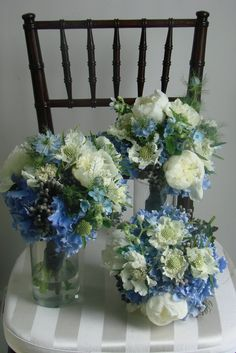 Scabiosa, peony, Dutch blue hydrangea, white hydrangea, tweedia, love-in-a-mist, and brazilla. Brazilla? not familiar with that or tweedia