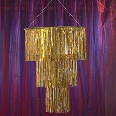The Gold Three Tier Chandelier features thousands of intricately detailed metallic mylar strands. Each of the gold tier chandeliers hangs 3 feet and is 32 inches in diameter. Masquerade Party Decorations, Masquerade Ball Party, Masquerade Theme, Prom Decor, Flapper Party, Gatsby Decorations, Wedding Decor, Wedding Ideas, Roaring Twenties Party